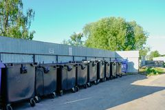 Row of black dumpsters in rural town  near moscow royalty free stock photo