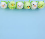 Row of easter chicks on blue background. Six easter chickens on blue background. Lots of Copy Space Royalty Free Stock Images