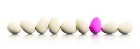 A row of easter eggs one dyed in pink. 3d illustration of a row of easter eggs one dyed in pink stock illustration