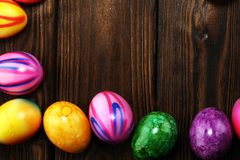 Row of Easter eggs on table. easter decoration. Row of Easter eggs on table. colorful easter decoration royalty free stock images