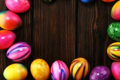 Row of Easter eggs on table. easter decoration. Row of Easter eggs on table. colorful easter decoration stock images