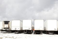 Tractor trailers in parking lot Stock Images