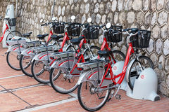 Row of electric bicycles Stock Images