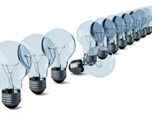 Row of electric bulbs on a white background. Stock Photo