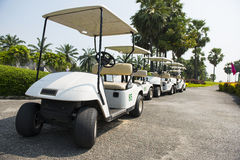 row of electric golf carts Royalty Free Stock Photos