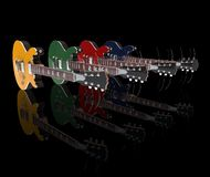 Row Of Electric Guitars. On black reflective background Stock Photography