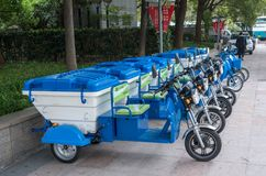 Row of electric tricycles for street cleaners in Shanghai royalty free stock images