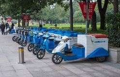 Row of electric tricycles for street cleaners in Shanghai royalty free stock image