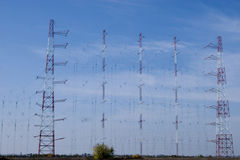 A row of electricity pylons Stock Images