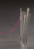 Row of embroidery sewing needles Royalty Free Stock Image