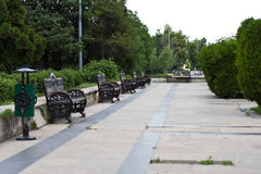 Row of empty benches in Carol Park, Bucharest Royalty Free Stock Images