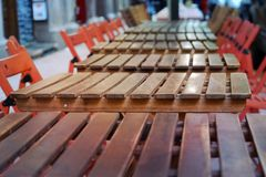 Row of empty cafe tables and chairs. Row of empty cafe tables, chairs Royalty Free Stock Images