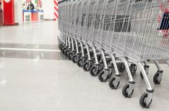 Row of empty cart in the supermarket Royalty Free Stock Photo