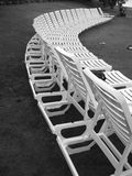 Row of Empty Chairs. Row of Plastic Chairs on the grass at a resort in the summer stock photo
