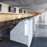 Row empty check-in desks Stock Image