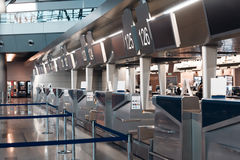 Row empty check-in desks. In international airport stock photos
