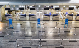 Row empty check-in desks Stock Photo