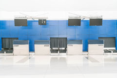 Row empty check-in desks Stock Images