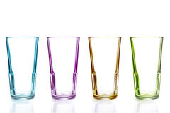 Row of empty colorful glasses Stock Photo