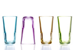 Row of empty colorful glasses Royalty Free Stock Photography