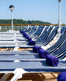 Row of Empty Deck Chairs on Cruise Ship Stock Image