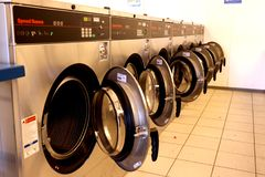 Front load washing machines in a laundromat royalty free stock images