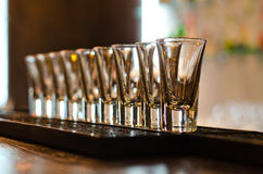 Row of empty glasses on a bar counter Royalty Free Stock Photography