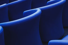 Row of empty, modern, soft and comfortable, blue chairs in a room for events. Stock Photos