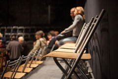 Row of empty plastic seats at conference Stock Images