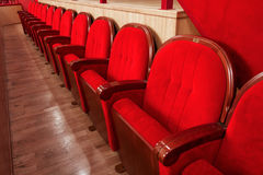 Row of empty red seats. Row of red velvet seats in the cinema theatre Royalty Free Stock Photos