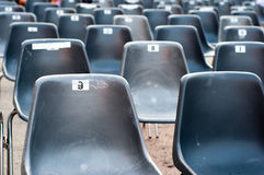 Row of empty seats with numbers Stock Image