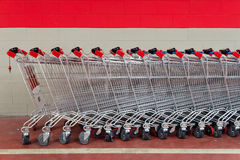 Row of empty shopping carts in supermarket Stock Photos