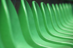 Row of Empty Stadium Seats. Empty green plastic stadium seats arranged in a row. The image has been made before the beginning of a tennis game Stock Image