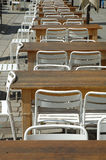 Row of empty tables and chairs Stock Photography