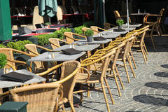 The row of empty tables with menu on pavement Stock Images