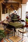 Row of empty tables under an arcade at an outdoor Royalty Free Stock Photography