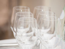Row of empty wine glasses on bar counter. Royalty Free Stock Images