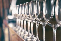 Row of empty wine glasses. On bar counter stock photo