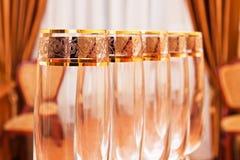 Row of empty wine goblets in restaurant Stock Photo