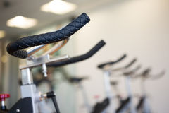 Row of exercise bikes focus on foreground Stock Photography