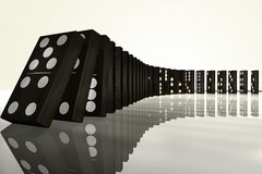 A row of falling dominoes. 3D rendering of a row of falling dominoes Royalty Free Stock Photo