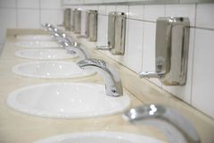 Row of faucet Royalty Free Stock Image