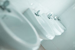 Row of faucets. In public toilet Royalty Free Stock Photography