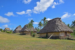 A row of Fijian bure in Navala, a village in the Ba Highlands of northern central Viti Levu, Fiji. These houses are traditional fijian wood and straw hut. This Stock Photos