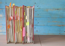 Row of file folders with messy documents, free copy space Royalty Free Stock Photos
