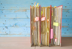 Row of file folders with messy documents, free copy space Stock Photography