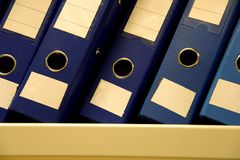 A row of files. In an office Stock Photo