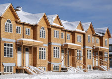 Row of ALMOST finished houses. In winter setting stock photos