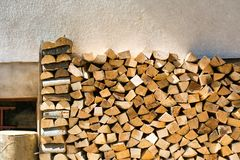 Row of firewood ordered by the wall Royalty Free Stock Images