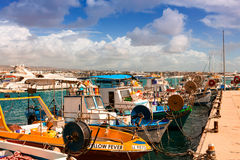 A row of fishing boats in a Cypriot harbor. Stock Image